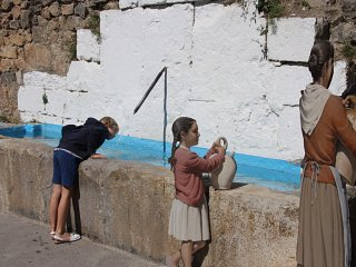Painted figures representing spanish life in a village street
