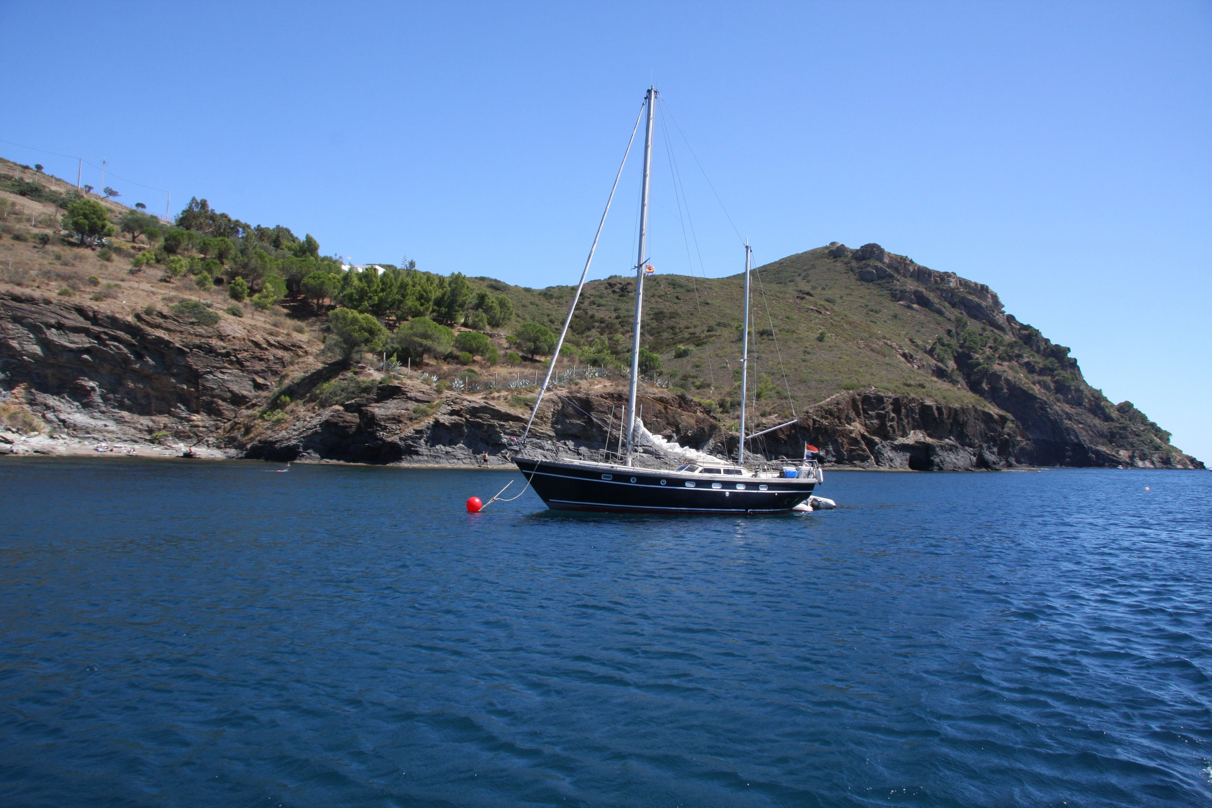 Sailing boat moored in bay